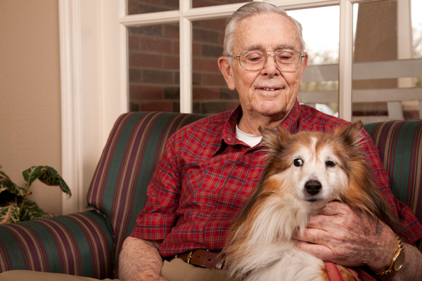 Happy-Senior-Adult-Man-Petting-His-Dog-Companion-000012481485_Large